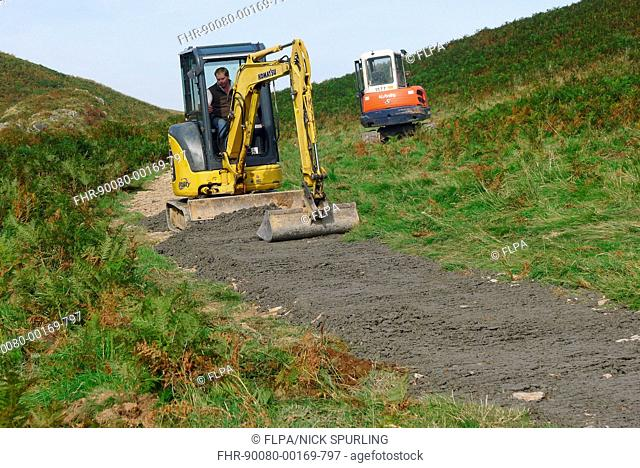 Repairing path on moorland with mini digger, between Simonsbath and Withypool, Exmoor N.P., Somerset, England, September