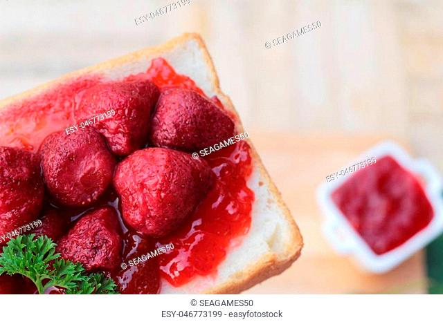 Strawberry jam with slice of bread delicious