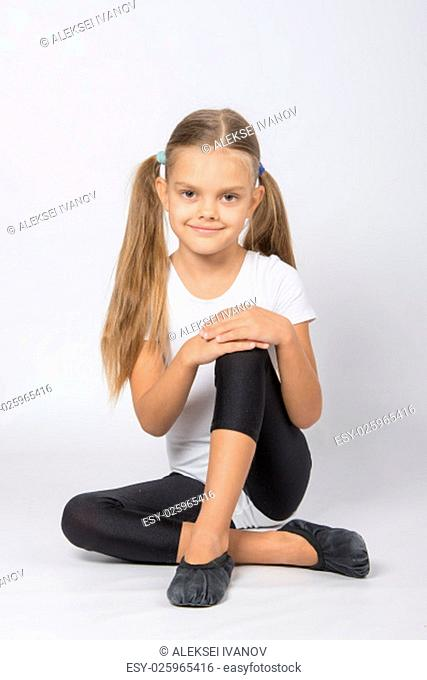 six year old girl aspiring gymnast performs a number of training exercises