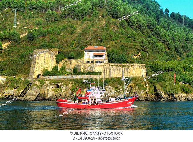 Fishing boat sailing and castle of Santa Isabel  Port of Pasajes  Basque Country  Spain