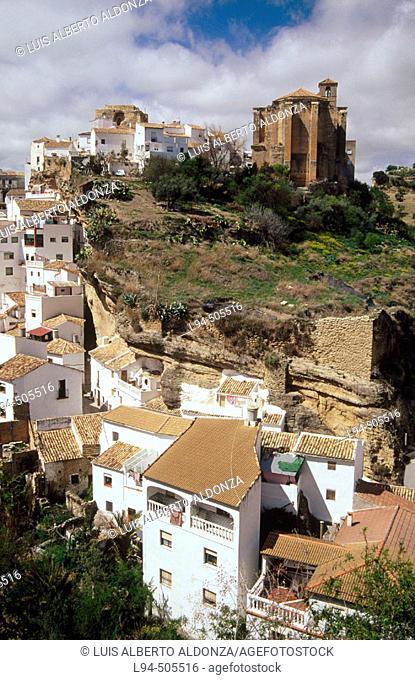 Setenil de las Bodegas. Nuestra Señora de la Encarnación Parish church and ruins of the Arab walls (XII-XIIIth centuries). Cádiz province. Andalusia