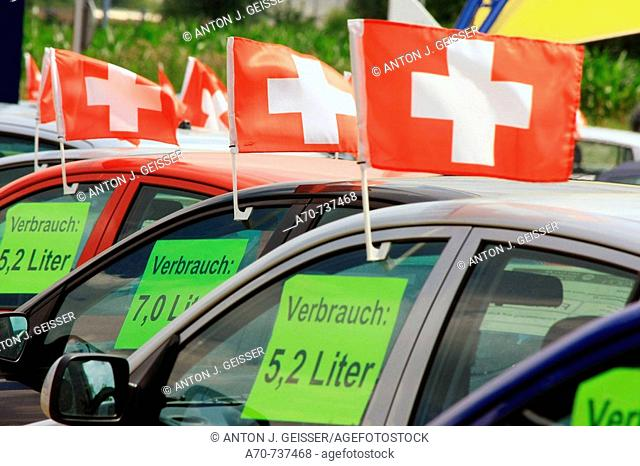 Used cars for sale, signs showing fuel consumption. Switzerland