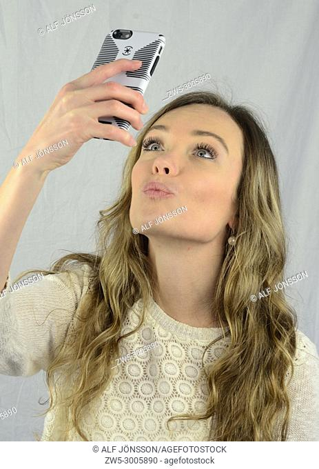 Young woman make a selfie with her smartphone