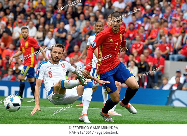 Alvaro Morata (R) of Spain vies for the ball with Tomas Sivok (L) of Czech Republic during the Group D soccer match of the UEFA EURO 2016 between Spain and...