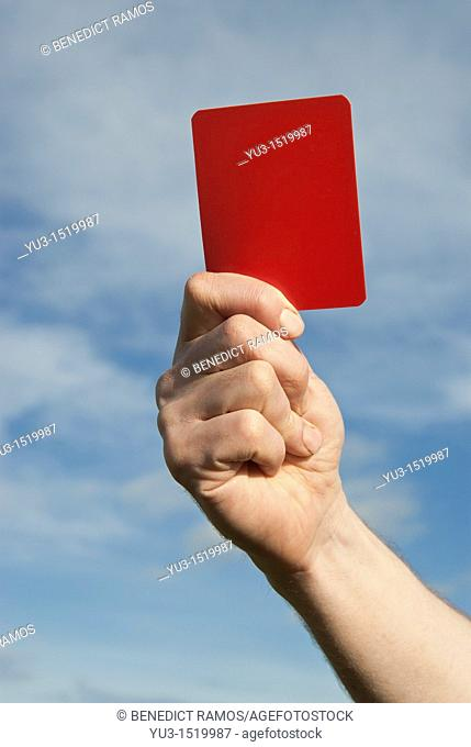 Referee waving a red card