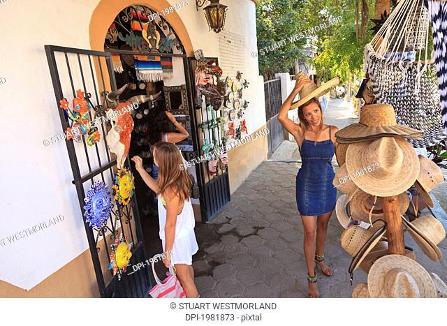 women shopping downtown, todos santos baja california mexico