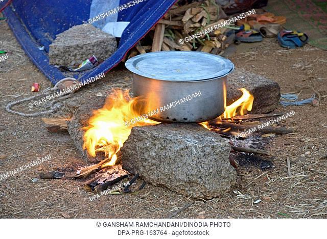 Utensil on firewood at Keesaragutta ; Hyderabad ; Andhra Pradesh ; India