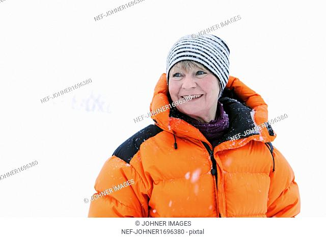 Smiling mature woman at winter