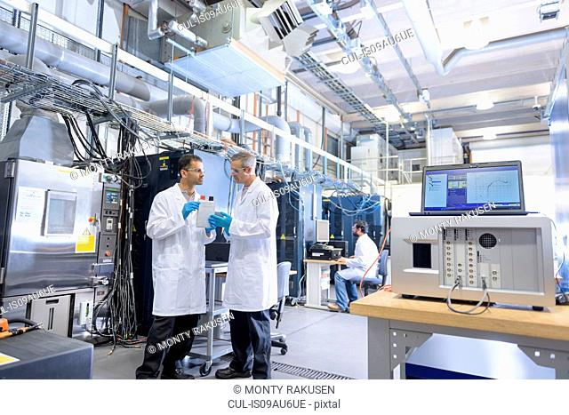 Scientists in lithium ion battery testing facility in battery research facility