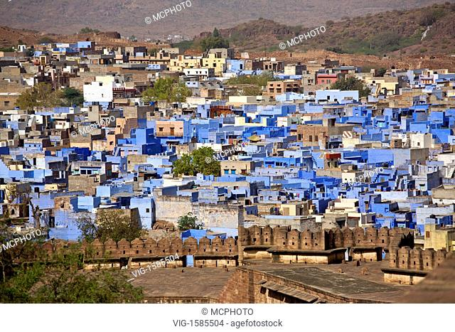 Morning light illuminates the MEHERANGARH FORT WALL and JOHDPUR also known as the BLUE CITY - RAJASTHAN, INDIA - 01/01/2009