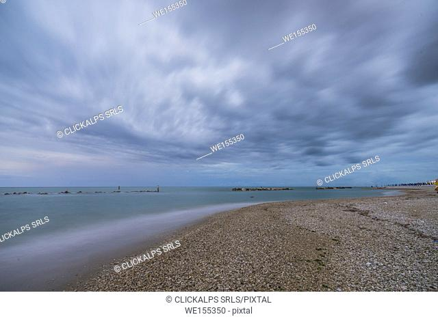 Storm clouds are reflected in the clear water at dusk Porto Recanati Province of Macerata Conero Riviera Marche Italy Europe