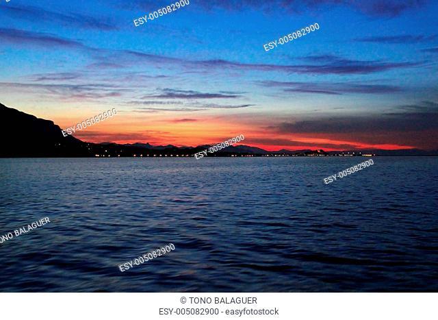Denia sunset view from sea Mediterranean backlight