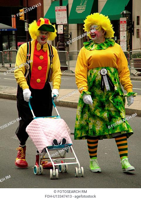 Philadelphia, PA, Pennsylvania, downtown, New Years Day, Philadelphia Annual Mummer's Day Parade, 2006, Comic Division, men dressed as couple with baby