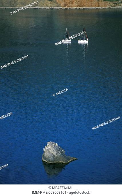 Two small boats on the sea, rock , Skopelos, Sporades, Greece