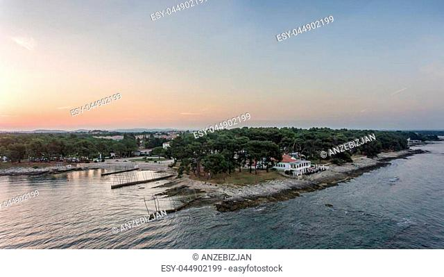 Spectacular aerial seascape panorama at sunrise. Beautiful coastline scenery from above