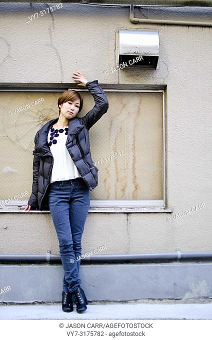 Japanese Girl poses on the street in Ebisu, Japan. Ebisu is an are located in Tokyo