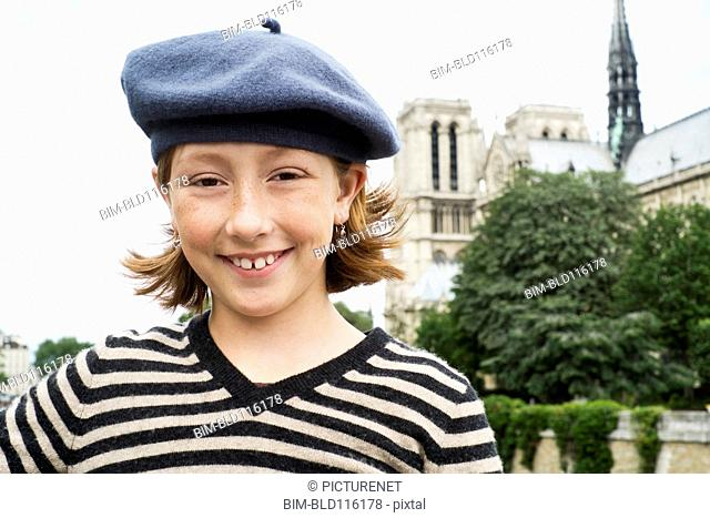 Caucasian girl smiling on city street, Paris, France