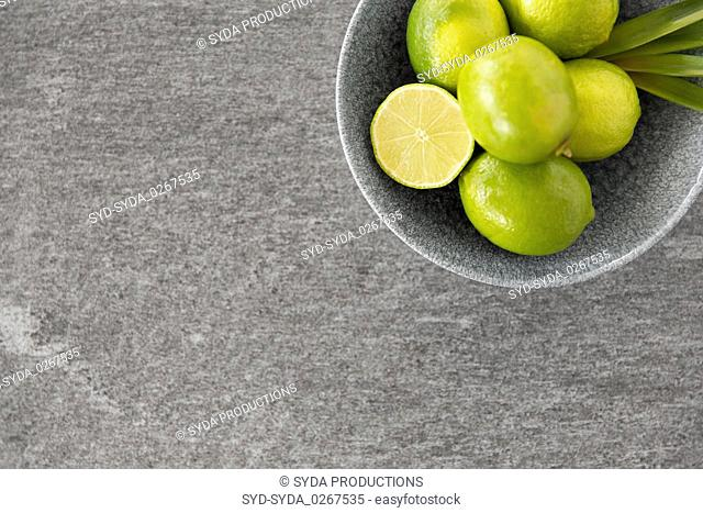 close up of whole limes in bowl