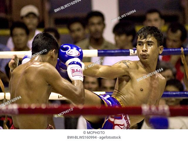 two Thai Boxer during Fight. One fighter is about to kick his opponent, Thailand