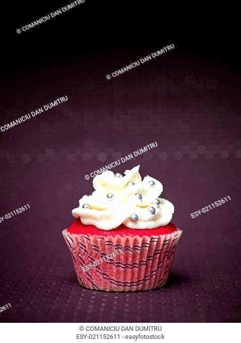 red cupcake purple background