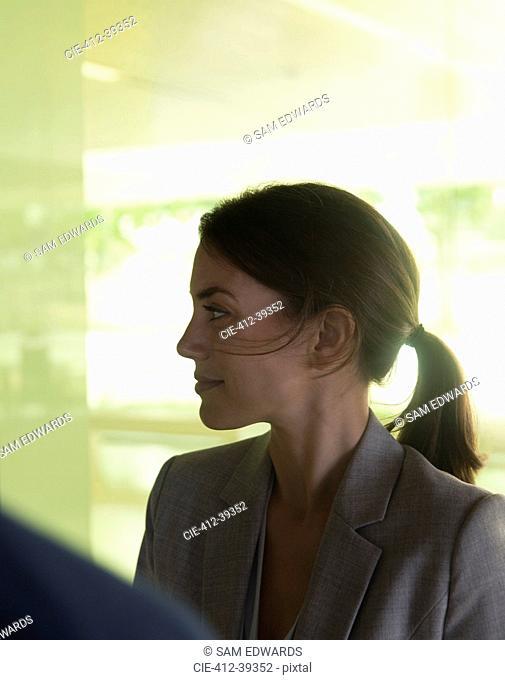 Profile brunette businesswoman listening, looking away