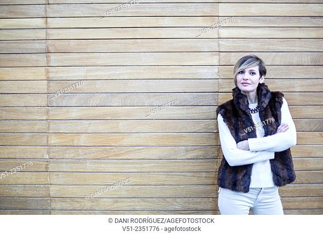 Portrait of a stylish woman outdoors looking at camera