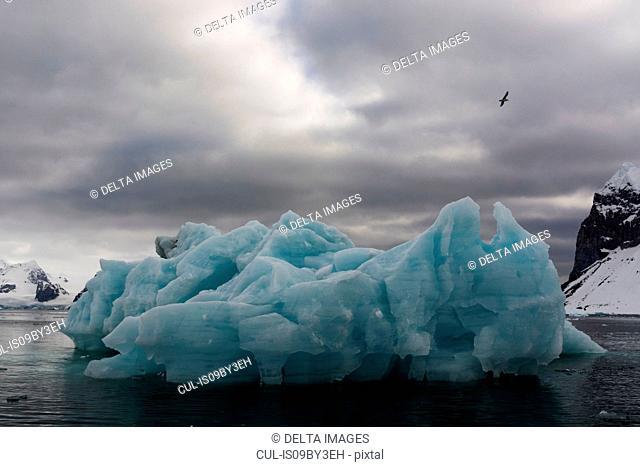 Blue iceberg and storm clouds, Burgerbukta, Spitsbergen, Svalbard, Norway