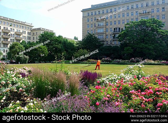 12 June 2020, Berlin: The lawn in the rose garden on Karl-Marx-Allee is watered. Photo: Alexandra Schuler/dpa. - Berlin/Berlin/Germany