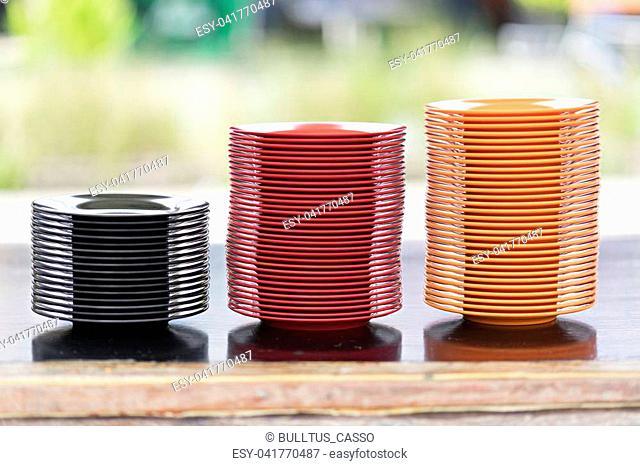 Melamine Black/Red/Orange Plate stack On a nature background