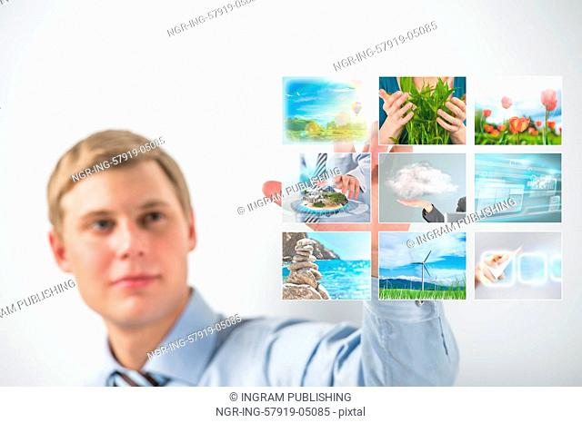 Man selecting tv channel on virtual touch screen