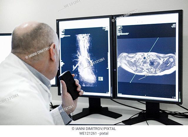 Radiologist reading MRI scan