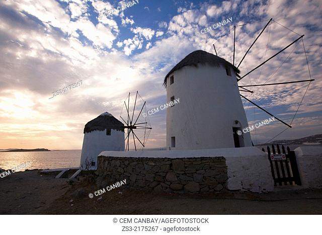 Traditional windmills at sunset in Little Venice District, Mykonos, Cyclades Islands; Greek Islands; Greece, Europe