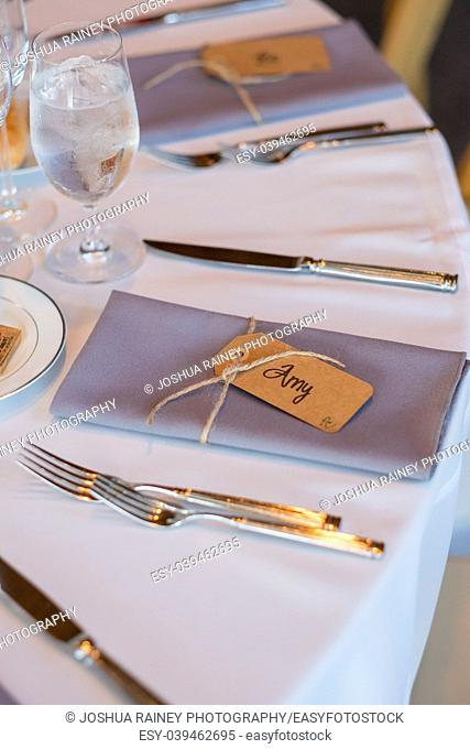 Wedding reception seating with folded napkin name tags to create a seating assignment for this beautiful event