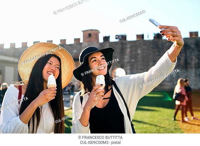 Friends taking selfie with ice cream cone, Pisa, Toscana, Italy