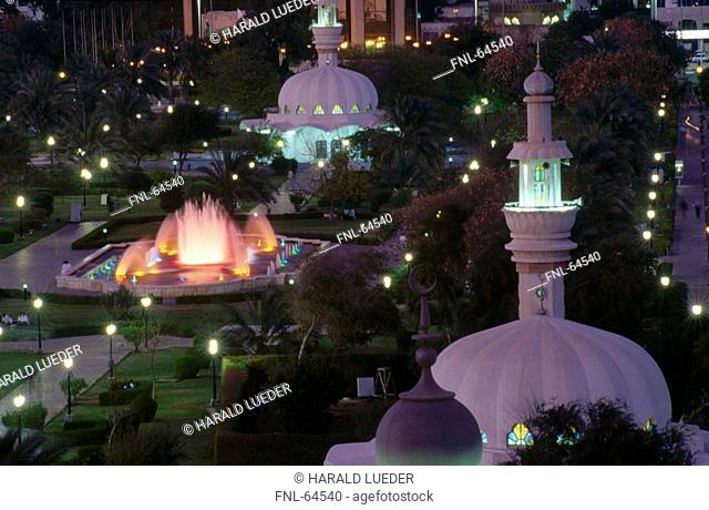 High angle view of mosque lit up at night, Abu Dhabi, United Arab Emirates