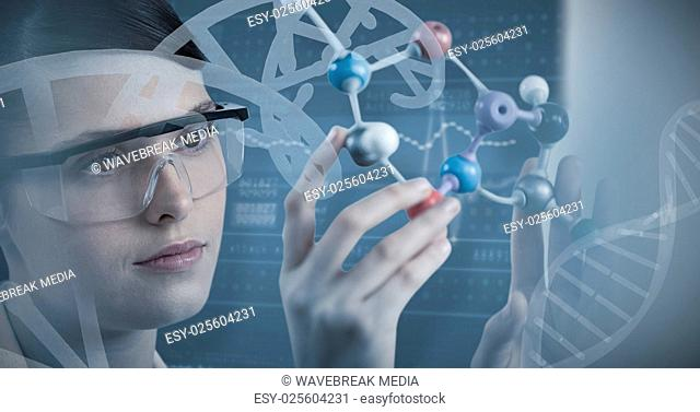 Composite image of close-up of scientist holding molecular model