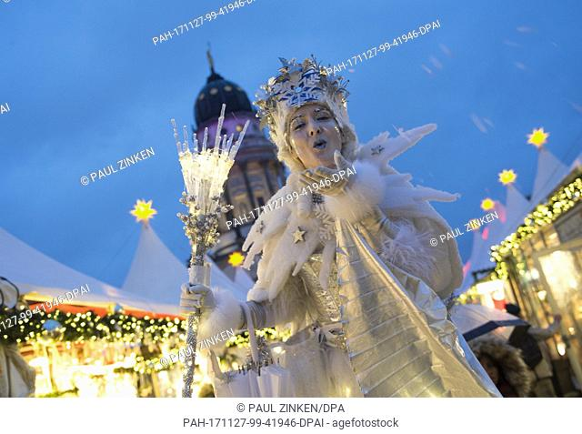 The snow queen greets visitors at the Gendarmenmarkt Christmas market in Berlin, Germany, 27 November 2017. The Christmas market at the Konzerthaus in Berlin...
