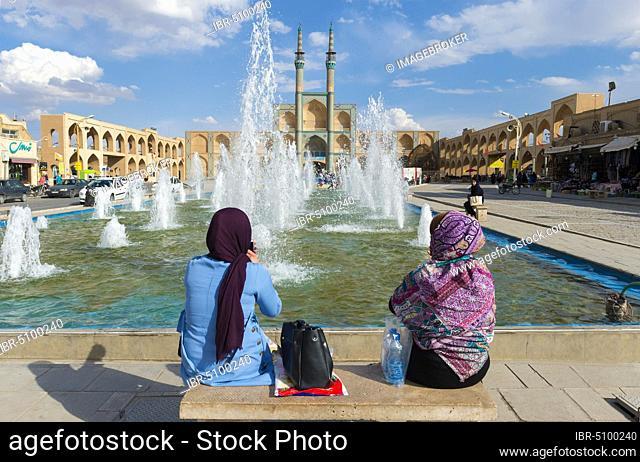 Iranian women sitting in front of Amir Chaqmaq complex, Yzad, Yazd province, Iran, Asia