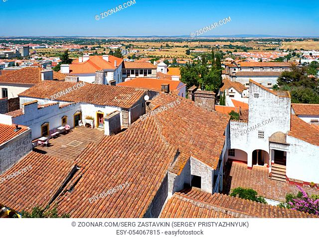 The view on the city residential houses surrounding the Cathedral (Se) of Evora from the roof of the church. Portugal