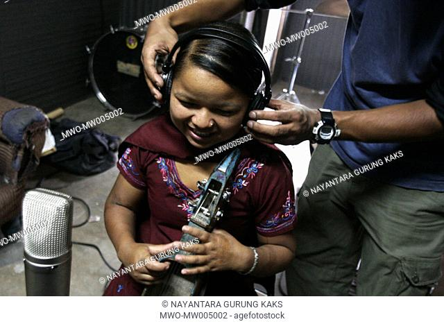 Preparing to record a few new songs, young songstress Barta Gandarva is from Bhojpur, a village in Nepal far away from recording studios and digital technology...