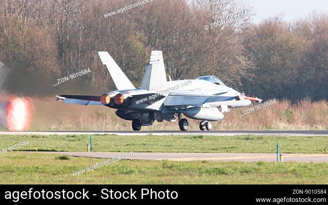 LEEUWARDEN, NETHERLANDS - APRIL 11, 2016: Finish Air Force F-18 Hornet landing during the exercise Frisian Flag. The exercise is considered one of the most...