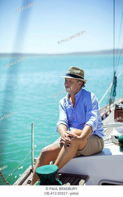 Older man sitting on boat outdoors
