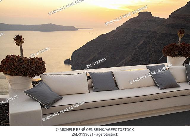 Comfortable couch overlooking the caldera sunset view in Thira, Fira, Santorini Greece