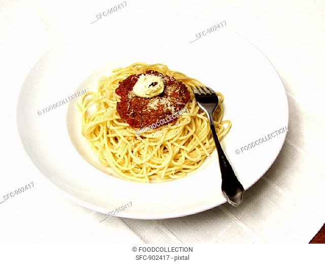 Spaghetti with Meat Sauce Topped with Butter