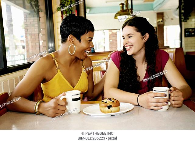 Women having coffee together in restaurant