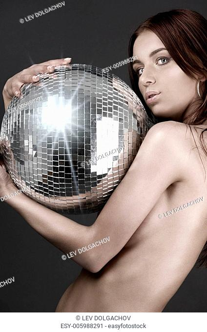 picture of beautiful naked woman with disco ball