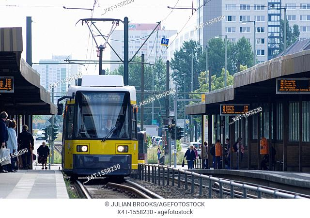 Modern tram pulling into a station in the former East Berlin