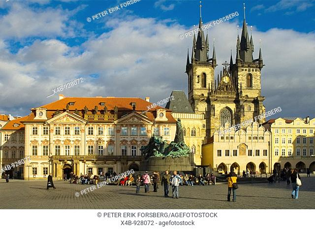 Old Town Square with Kinsky Palace, Jan Hus Monument, and Tyn Cathedral in Prague Czech Republic
