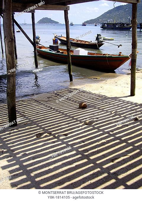 Boats under the timber pier in Koh Tao, Thailand under the timber pier in Koh Tao, Thailand