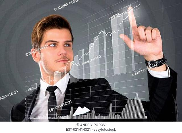 Businessman Touching Transparent Screen With Growing Bar Graph